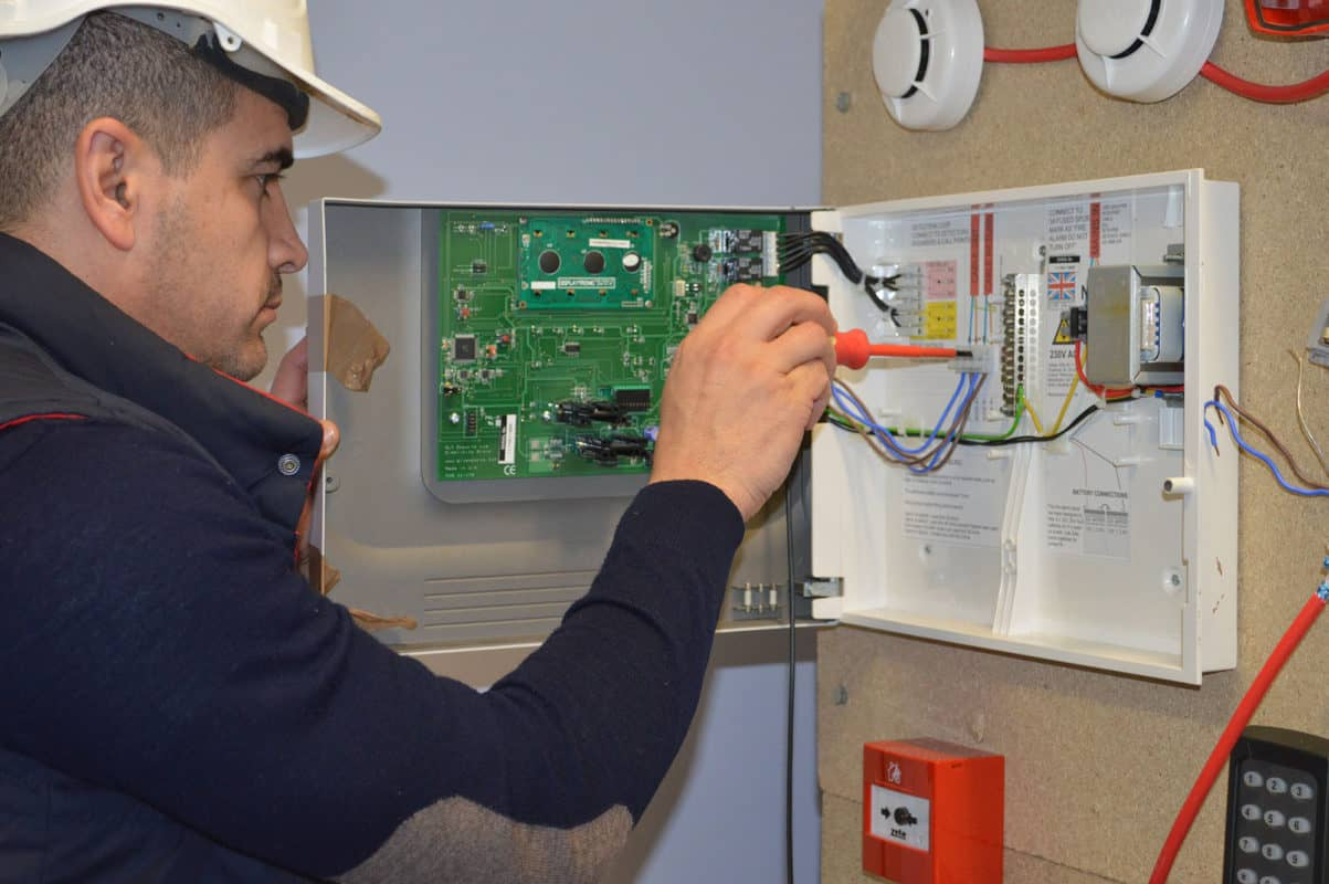 Engineer working on alarm system