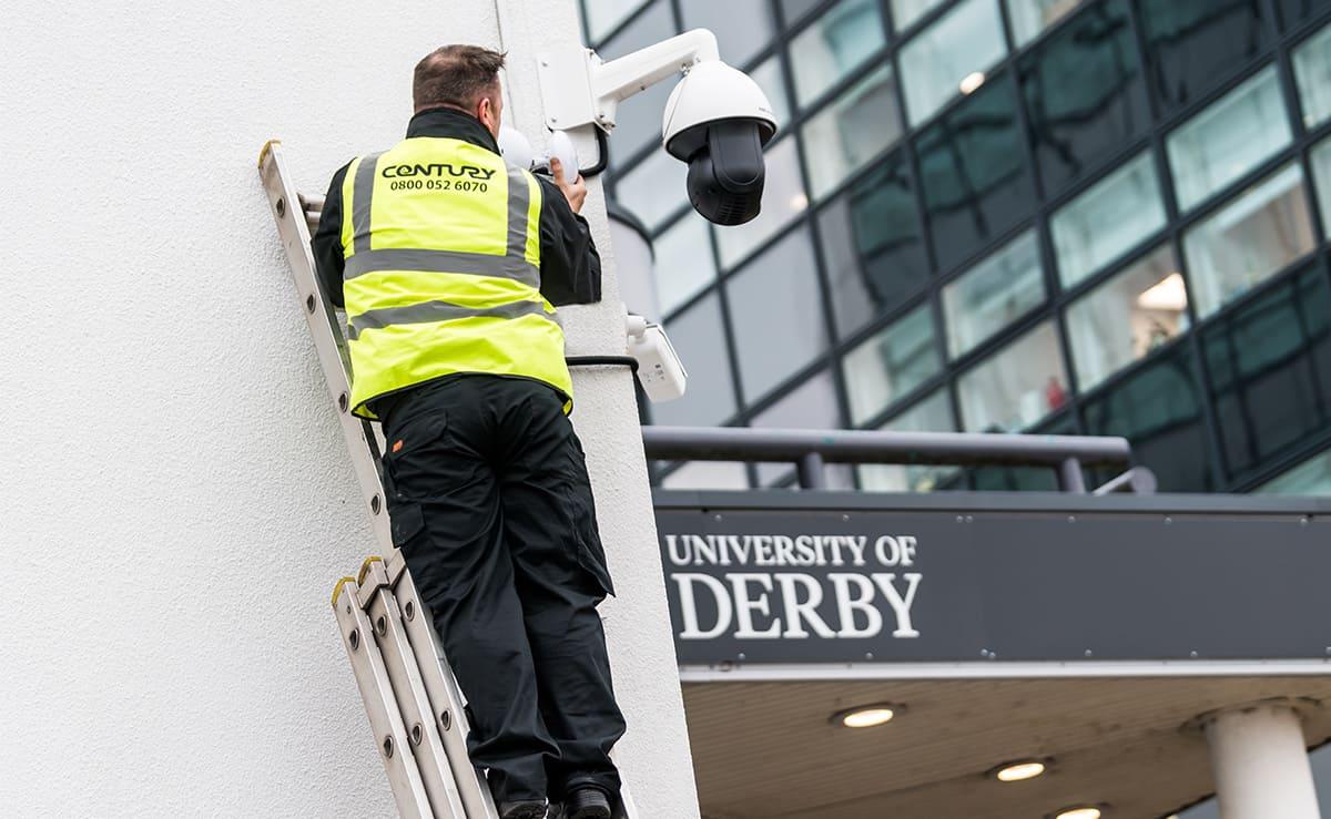 Engineer working on outdoor security camera