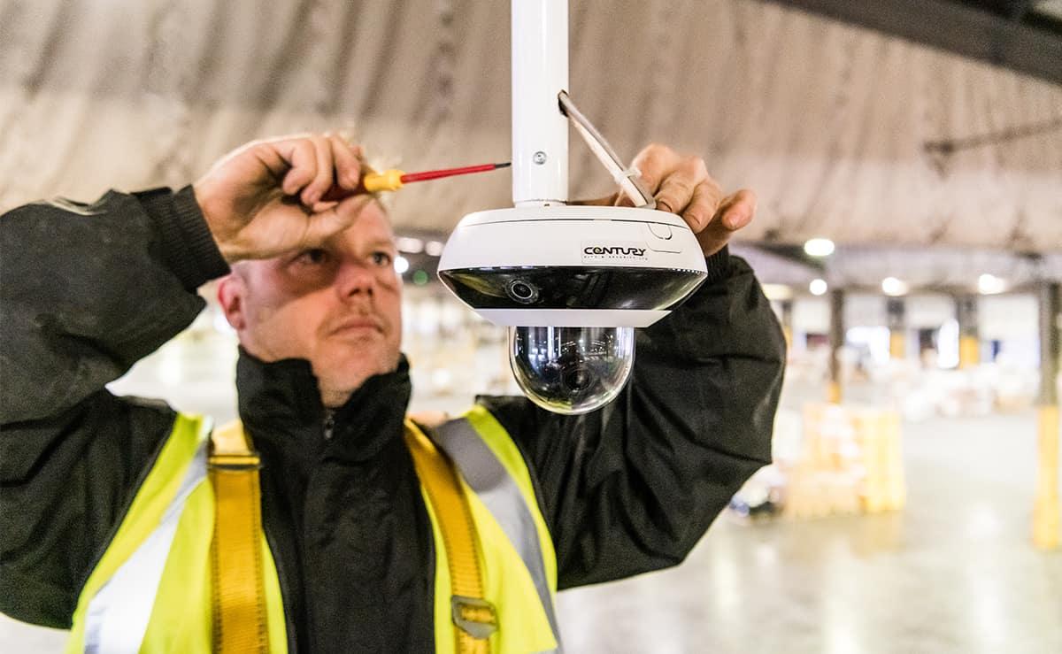 Engineer fitting CCTV camera