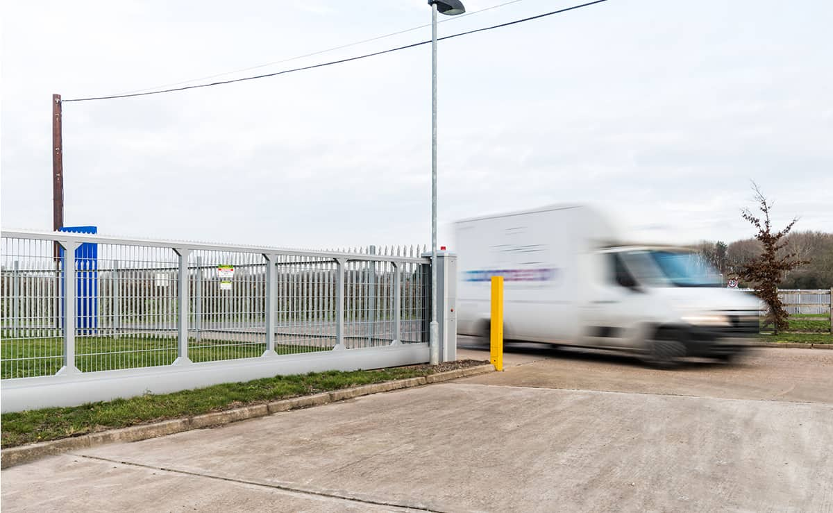 Van driving through automatic sliding gate