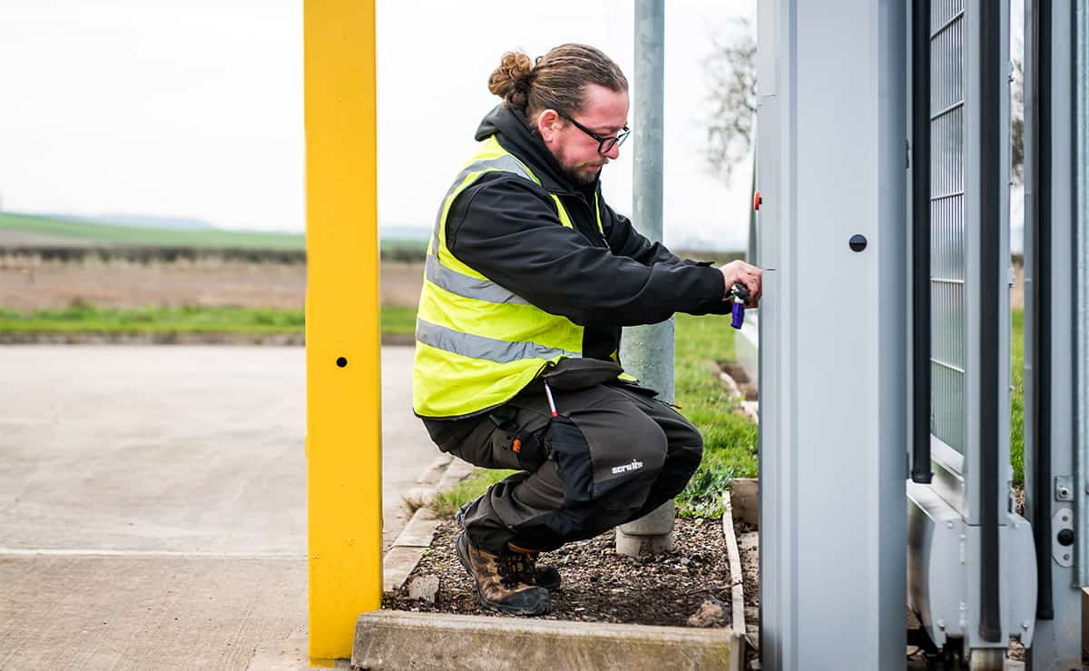 Engineer maintaining automatic gate